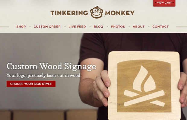 tinkering monkey beige brown website layout